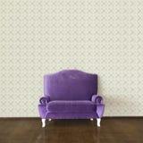Purple sofa and wallpaper Royalty Free Stock Image