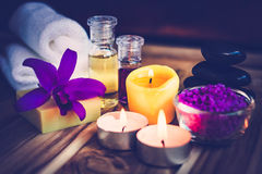 Purple Spa Theme with Bath Salt, Oil,  candle and Orchid. Stock Images