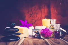 Purple Spa Theme with Bath Salt, Oil,  candle and Orchid Royalty Free Stock Image