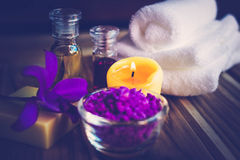 Purple Spa Theme with Bath Salt, Oil,  candle and Orchid Royalty Free Stock Photo