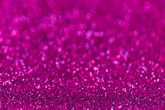 Purple sparkling background from small sequins, closeup. Brilliant backdrop Stock Images
