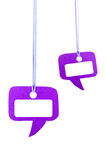 Purple speech bubble hanging on white Stock Image