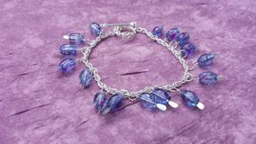 Purple splatter anklet Royalty Free Stock Photos
