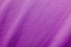 Sports clothing fabric jersey texture. Purple sports clothing fabric jersey texture Royalty Free Stock Photography