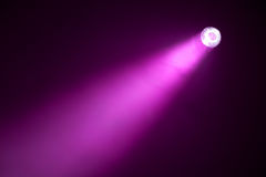 Purple spotlight. Purple ray of spotlight in the darkness Royalty Free Stock Images