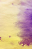 purple spreads ink on white wrinkled paper with a yellow tinge Royalty Free Stock Photography