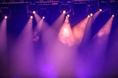 Purple stage spotlights. Hanging on lighting pipe systems royalty free stock image