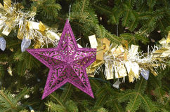 Purple star Christmas ornaments gold silver tinsel garland Stock Image