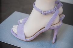 purple stileto shoes on mannequin in fashion store sh Stock Photo