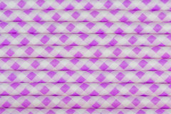 Purple straws up close. Stack of purple party straws are stacked making for a designed background Stock Photography