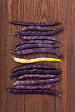 Purple string beans on a wooden background. Purple string beans on wooden background Stock Photos