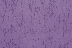Purple stucco with embossed backdrop on concrete wall. Abstract violet pattern on the ribbed wall. Painted violaceous textured sur stock image