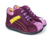 Purple suede baby shoes with laces Stock Images