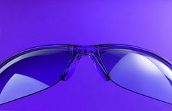 Purple sunglasses Stock Images