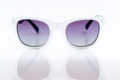 Purple sunglasses with white picture frame Royalty Free Stock Image