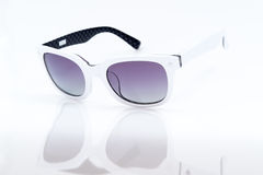 Purple sunglasses with white picture frame Stock Photos