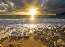 Purple sunrise on beach of Mediterranean Sea Royalty Free Stock Photos