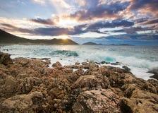 Purple sunrise on beach of Mediterranean Sea Royalty Free Stock Photo