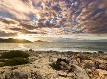 Purple sunrise on beach of Mediterranean Sea Stock Photography