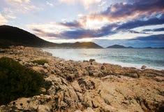 Purple sunrise on beach of Mediterranean Sea Stock Photo