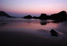 Purple sunrise at the Indian ocean coast Stock Photos