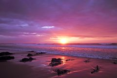 Purple sunset at the atlantic ocean Stock Photo