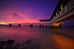 Purple sunset at Bagan Datoh Malaysia jetty stock photo. Purple sunset at Bagan Datoh Malaysia jetty. Taken using long exposure tecknique with helps from filters Royalty Free Stock Photo