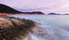 Purple sunset on beach of Mediterranean Sea Royalty Free Stock Photos