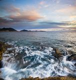 Purple sunset beach of Mediterranean Sea Stock Images