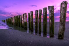 A purple sunset at the beach royalty free stock image