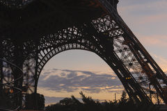 Purple sunset behind base of Eiffel Tower Stock Images