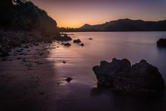 Purple sunset in Cape Hillsborough national park, Australia Royalty Free Stock Photo