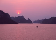 Purple sunset in Halong Bay. Vietnam, Southeast Asia royalty free stock images