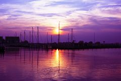 Purple sunset in the harbor of Marken Holland Stock Photo