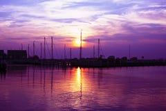 Purple sunset in the harbor of Marken Holland. Purple sunset in the harbor of Marken in the Netherlands Stock Photo