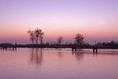 Purple sunset in the Netherlands Stock Photos