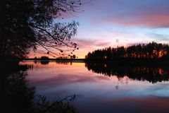 Purple sunset over Karelian lake Royalty Free Stock Images