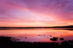 Purple sunset over sea water. Romantic sunset over sea water Royalty Free Stock Images