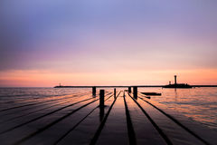 Purple sunset on sea with pier Stock Photography