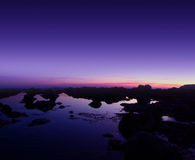 Purple sunset and seaside Stock Photos