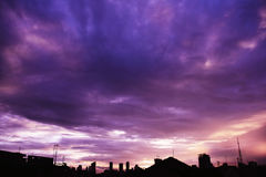 Purple sunset sky over cityscape Royalty Free Stock Photo
