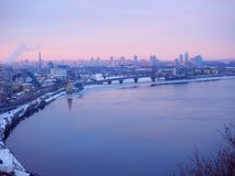 Purple sunset time over most city. Panorama of Kiev with river Dnieper. Stock Photography