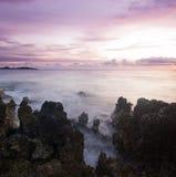 Purple sunset on volcanic beach of Mediterranean Stock Photo