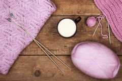 Purple sweater with a cup of warm milk. Women's delicate purple sweater with a cup of warm milk Royalty Free Stock Images