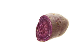 Purple sweet potato. Fresh purple sweet potato isolated on the white background Stock Photo