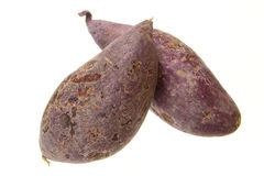 Purple sweet potato. Fresh purple sweet potato isolated on the white background Royalty Free Stock Images