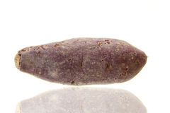 Purple sweet potato. Fresh purple sweet potato  on the white background Stock Photo