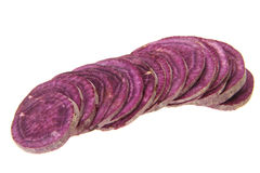 Purple sweet potato. Pieces of fresh purple sweet potato isolated on white background Stock Photos