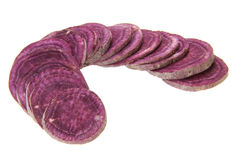 Purple sweet potato. Pieces of fresh purple sweet potato isolated on white background Stock Images