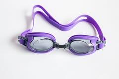 Purple swim goggles  on white background Stock Photos